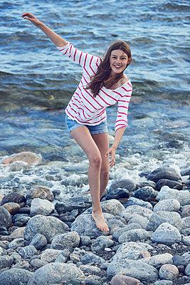 Girl walking at sea - p312m1210977 by Johan Alp