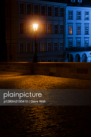 Street lamp on Charles Bridge at night - p1280m2193410 by Dave Wall