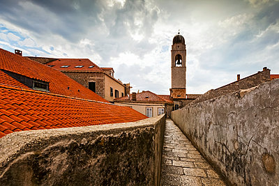 City walls and tower of the Franciscan Monastery; Dubrovnik, Croatia - p442m1225021 by Terence Waeland