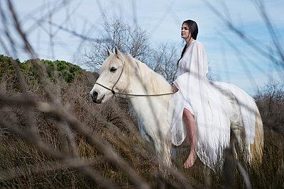 Woman riding a horse - p1041m1042365 by Franckaparis
