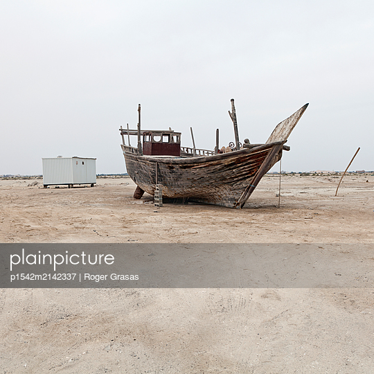 Old wooden boat in the middle of the desert - p1542m2142337 by Roger Grasas