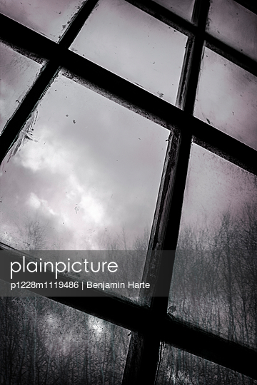 Thunderstorm through an old window - p1228m1119486 by Benjamin Harte