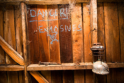 Old gas lamp with danger explosives  - p1201m1039951 by Paul Abbitt