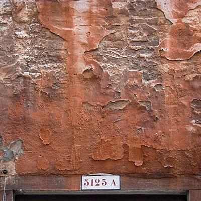 Peeling plasterwork on Venice building exterior. - p8552304 by Mike Burton