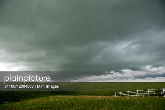 Storm clouds over rural landscape,NA, Kansas, USA - p1100m2084305 by Mint Images