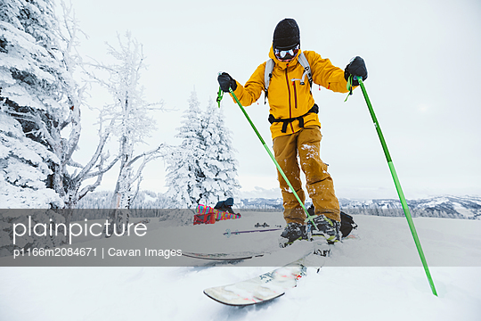 skier clips in to binding after hiking to ski Wyoming backcountry - p1166m2084671 by Cavan Images
