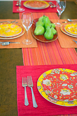 Detail colorful place settings on dining room table - p5551881f by Auda & Coudayre Photography