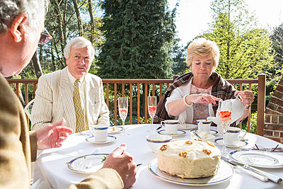Senior people having tea on the balcony - p1026m1164202 by Patrick Frost