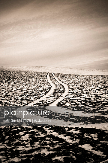 Field with tracks in the snow - p813m1217378 by B.Jaubert