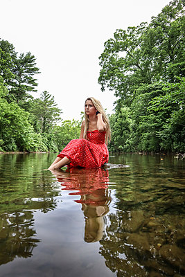 Girl In Red Dress in Stream - p1019m2100423 by Stephen Carroll