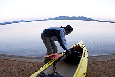 Woman kayaking on Lake Ossipee - p3437404f by Justin Bailie