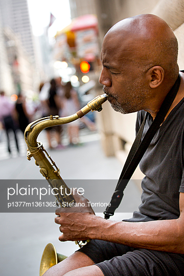 Saxophone player, street musician - p1377m1361362 by Stefano Torrione
