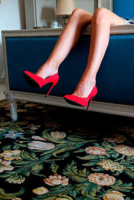 Red high heels and legs of a woman - p1521m2126554 by Charlotte Zobel