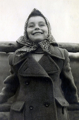 Girl wearing coat - p1541m2172492 by Ruth Botzenhardt