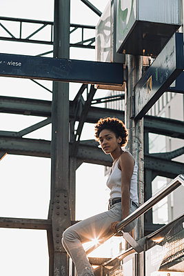 Female teenager on bridge - p728m2038814 by Peter Nitsch