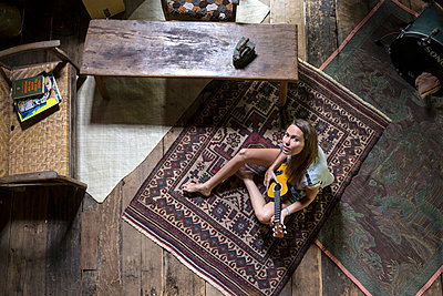 Young woman in Sulawesi wood house - p1108m1004226 by trubavin
