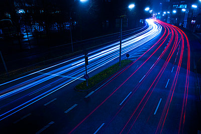 Street with light trails at night - p851m1048621 by Lohfink