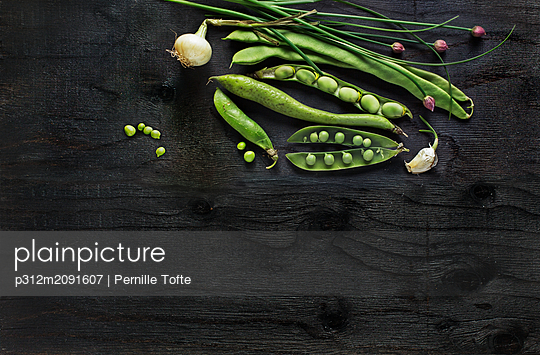 Root vegetables on black background - p312m2091607 by Pernille Tofte