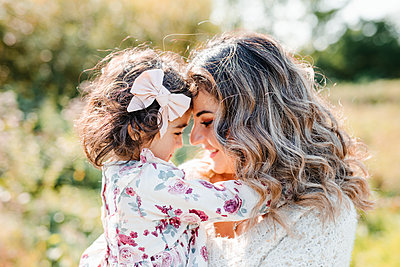 Mother and daughter looking at each other - p312m2249723 by Anna Johnsson