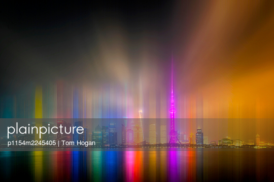 China, Shanghai, Skyline at night - p1154m2245405 by Tom Hogan