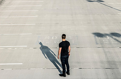 Man on parking deck - p1019m1424617 by Stephen Carroll