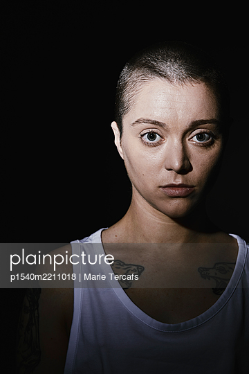 dramatic portrait of an androgynous woman - p1540m2211018 by Marie Tercafs