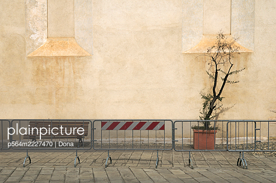 Movable metal barriers outside a church - p564m2227470 by Dona