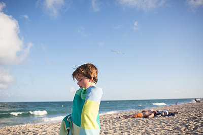 Boy at the beach - p1308m2065293 by felice douglas