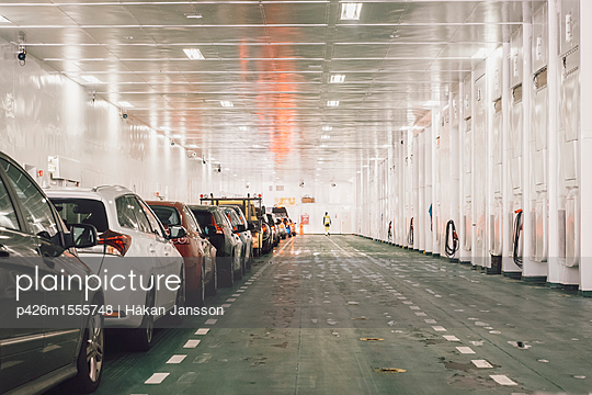 Row of cars parked in factory - p426m1555748 by Håkan Jansson