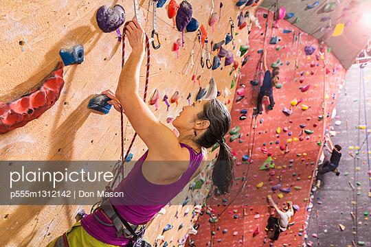 Climbers scaling rock wall - p555m1312142 by Don Mason