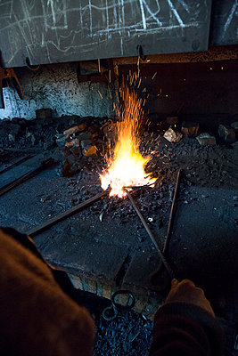 Blacksmith at work in his workshop - p300m1205394 by Andrés Benitez