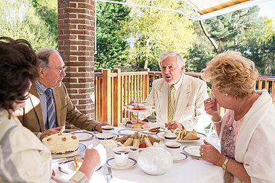 Senior people having tea on the balcony - p1026m1164200 by Patrick Frost