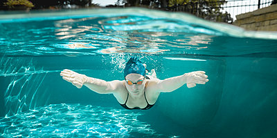 Young female swimmer during training - p1554m2272602 by Tina Gutierrez
