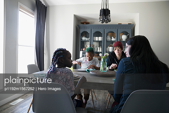 Homosexual couple and children eating at dining table - p1192m1567252 by Hero Images