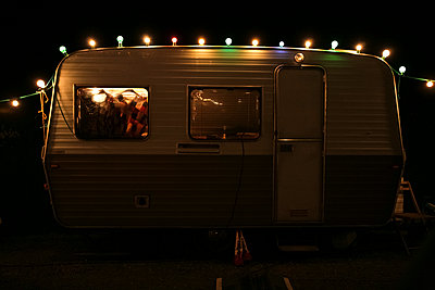 Fairy lights on a caravan - p927m1132560 by Florence Delahaye