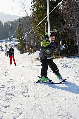 Boy on ski lift - p312m2052494 by Lina Arvidsson