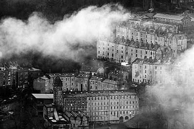 England, West Yorkshire, Hebden Bridge. Houses and mills in clearing mist. - p651m2152398 by Robert Birkby