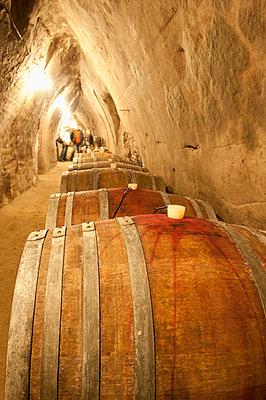 Wooden wine barels in sandstone wine cellar, Novy Saldorf, Brnensko, Czech Republic, Europe - p871m731986 by Richard Nebesky