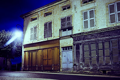 Abandoned house with shop at night - p1312m2228681 by Axel Killian