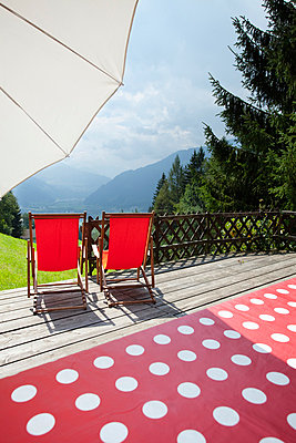 Log Cabin chalet wooden porch red chairs mountains - p609m765471 by WRIGHT