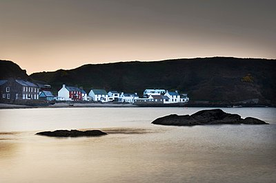 View of Porthdinllaen village at dusk, North Wales, UK - p429m1047199 by Craig Easton