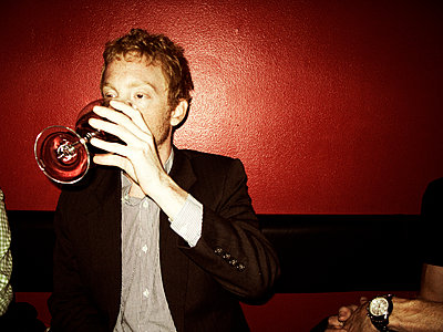 Man drinking red wine - p972m1088651 by Björn Terring