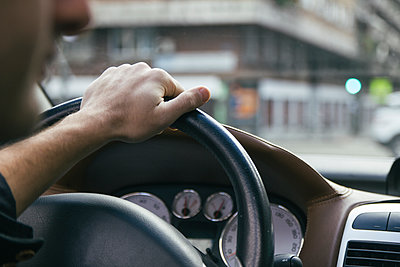 Hand of a man driving a car - p300m1120495f by Andrés Benitez