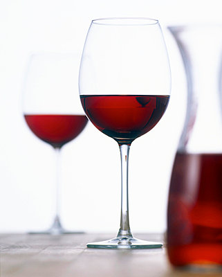 Glasses of red wine and carafe - p3001631f by Tom Hoenig