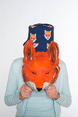 Woman with fox mask and hat - p1621m2231583 by Anke Doerschlen