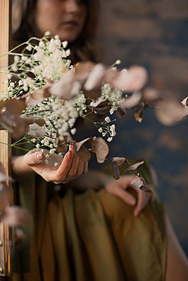 Woman's hand and flowers - p1642m2216203 by V-fokuse