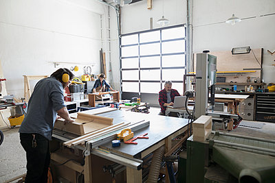 Carpenters working in workshop - p1192m1490219 by Hero Images