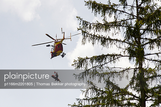 Helicopter evacuating injured motorcycle rider, Annecy, Haute Savoie, France - p1166m2201805 by Thomas Bekker photography