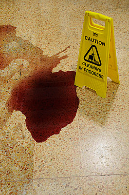Red wine spilt on supermarket floor - p1072m829348 by Neville Mountford-Hoare