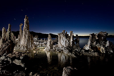Scenic view of rocks in Mono Lake against sky at night - p1166m1519238 by Cavan Images